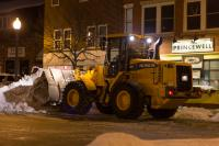 Photo of front-loader plowing snow